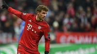 4. Meskipun terus menolak jika dikatakan akan pindah dari Bayern Munchen. Hal itu tidak membuat Manchester City berhenti menggoda striker asal Jerman, Thomas Muller untuk kembali bermain bersama Guardiola. (AFP/Christof Stache)
