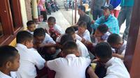 Heboh pemotongan rambut murid SD di Banyuwangi (Liputan6.com/Dian Kurniawan)