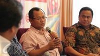 Anggota DPR Muh. Sarmuji (tengah) berbicara saat diskusi di Jakarta, (6/2). Jika banyak Investor yang hengkang maka akan berdampak buruk bagi perekonomian di Indonesia. (Liputan6.com/Angga Yuniar)