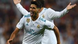 Gelandang Real Madrid, Marco Asensio berada pada peringkat kedua daftar top scorer Los Blancos, Asensio total mencetak tujuh gol di semua leel kompetisi. (AFP/Gabriel Bouys)