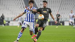 Bruno Fernandes kembali menjaringkan bola ke dalam gawang Real Sociead pada menit ke-57, dengan sepakan kaki kanan. (Foto: AP/LaPresse/Marco Alpozzi)