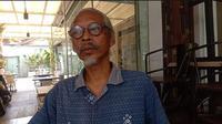 Uke di gerainya baju khas Kalimantan.(Foto: Aceng Mukaram/Liputan6.com)