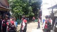 Suasana rekonstruksi pembunuhan bocah di dalam karung (Liputan6.com/Achmad Sudarno)