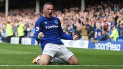 Wayne Rooney merupakan pemain yang memulai karier di Everton sebelum menjadi penyerang andalan Manchester United. Ia kembali ke skuat The Toffes setelah 13 musim bersama Setan Merah dan mampu mencetak gol di laga pertamanya kala menghadapi Stoke City. (Foto: AFP/Oli Scarff)