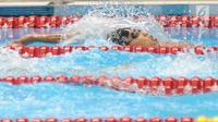 Perenang Indonesia,Triady Fauzi Sidiq saat bertanding pada 200 meter gaya ganti perorangan putra.Asian Games 2018 di Stadion Akuatik GBK, Jakarta, Senin (20/8).  (merdeka.com/Arie Basuki)