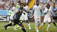 Pemain Uruguay, Luis Suarez merayakan gol ke gawang Arab Saudi pada laga grup A Piala Dunia 2018 di Rostov Arena, Rostov-on-Don, Rusia, (20/6/2018). Uruguay menang 1-0. (AP/Andrew Medichini)