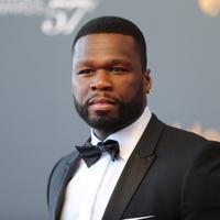 50 Cent dibesarkan oleh ibunya yang ternyata adalah seorang lesbian dan pecandu kokain. Ibunya sendiri meninggal saat usianya 8 tahun. (VALERY HACHE / AFP)