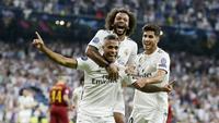 Para pemain Real Madrid merayakan gol yang dicetak oleh Mariano Diaz ke gawang AS Roma pada laga Liga Champions di Stadion Santiago Bernabeu, Madrid, Rabu (19/9/2018). Real Madrid menang 3-0 atas AS Roma. (AP/Manu Fernandez)