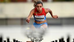 Atlet Rusia, Ekaterina Galitskaya, beraksi di nomor lari gawang 100m putri kejuaraan Stars of 2016 di Moscow, Rusia, (28/7/2016). (AFP/Kirill Kudryavtsev)