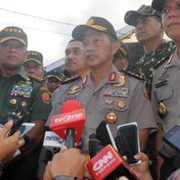 Kapolri Jenderal Tito Karnavian memberi keterangan pers usai melihat jasad Santoso di RS Bhayangkara Palu (Liputan6.com/Dio Pratama)