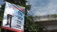 Sebuah spanduk yang menggambarkan sosok Jokowi terpampang jelas di sekitar Pospera, di Terminal Kampung Melayu, Jakarta, (29/5/2014). (Liputan6.com/Faizal Fanani)