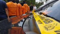 Ketujuh pemuda yang berprofesi sebagai sopir taksi online itu menggunakan GPS palsu. Foto: (Fauzan/Liputan6.com)
