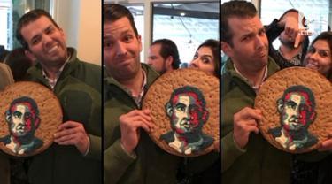 Anak Presiden Trump menjadi pembicaraan warganet setelah mengunggah foto dirinya dengan kue bergambar muka Barack Obama.