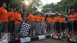 Kapolda Metro Jaya, Irjen Pol Tito Karnavian meluncurkan Satuan Segway Direktorat Pengaman Objek Vital di Bundaran HI, Jakarta, Minggu (13/9/2015). Sebanyak 7 segway baru dipakai untuk pengamanan jalannya car free day. (Liputan6.com/Gempur M Surya)