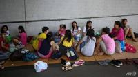 Pekerja domestik asal Filipina di Hong Kong. (AFP/ Vivek Prakash)
