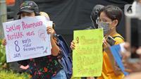 Aksi aktivis Perempuan Mahardhika memperingati Hari Perempuan Sedunia di Kawasan Patung Kuda Arjuna Wijaya, Jakarta, Senin (8/3/2021). Mereka meminta segera pemerintah mengesahkan RUU Perlindungan PRT, Ratifikasi Konvensi ILO 190 beserta rekomendasi 206. (Liputan6.com/Herman Zakharia)