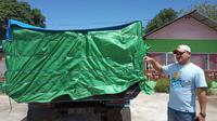 Satuan Reserse Narkoba Polres Gorontalo menyita sebuah mobil dump truck bernomor polisi DB 8816 EY yang bermuatan 5,8 ton minuman keras (Miras) jenis cap tikus. (Liputan6.com/ Arfandi Ibrahim)