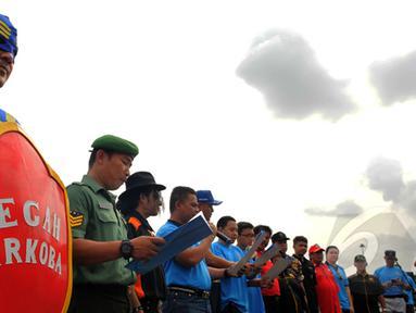 Badan Narkotika Nasional (BNN) Provinsi DKI Jakarta menggelar acara Gerakan Wajib Lapor Bagi 100.000  masyarakat Jakarta yang menggunakan Narkoba agar dapat menjalani proses kesembuhan. di Monas, Jakarta, Sabtu,(28/2/2015). (Liputan6.com/Faisal R Syam)