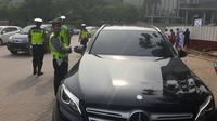 Sebanyak 125 mobil mewah terjaring razia di kawasan elite Pantai Indah Kapuk, Jakarta Utara. (Liputan6.com/Moch Harun Syah)