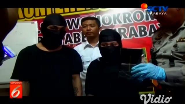 Pasangan kekasih DP (23) dan SA (22) harus berurusan dengan polisi terkait aksi kejahatannya di restoran Jalan Adityawarman, Surabaya.