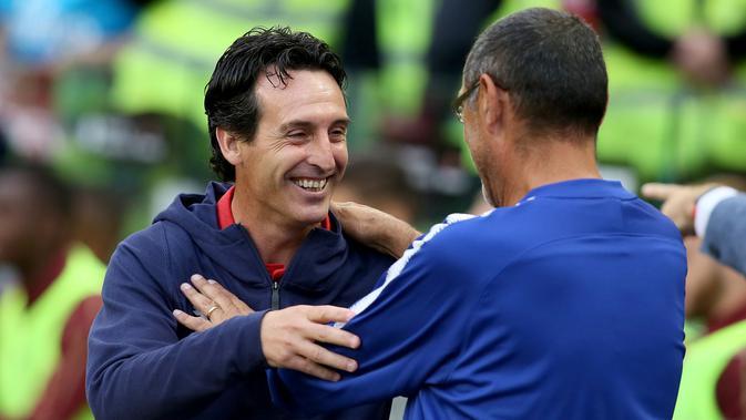 Pelatih Arsenal Unai Emery (kiri) (AFP Photo/Paul Faith)