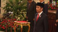 Presiden Joko Widodo saat memimpin penganugerahan gelar Pahlawan Nasional di Istana Negara, Jakarta, Kakis (8/11). Keputusan penganugerahan gelar Pahlawan Nasional termaktub dalam Keputusan Presiden Nomor 123/TK/2018. (Liputan6.com/Angga Yuniar)