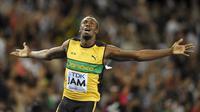 Pelari tercepat dunia, Usain Bolt, enggan bergabung bersama MU karena Louis Van Gaal. (Reuters/Carl Recine)