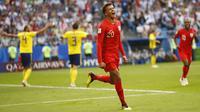Gelandang Inggris, Dele Alli, merayakan gol yang dicetaknya ke gawang Swedia pada laga perempat final Piala Dunia di Samara Arena, Samara, Sabtu (7/7/2018). Inggris menang 2-0 atas Swedia. (AP/Matthias Schrader)