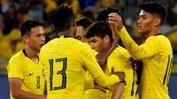 Timnas Malaysia merayakan gol ke gawang Timor Leste dalam leg kedua putaran pertama kualifikasi Piala Dunia 2022 di Stadion Nasional Bukit Jalil, Kuala Lumpur (10/6/2019), (Bola.com/Dok. FAM)