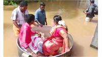 Akibat Banjir, Pengantin Ini Rela Naik Panci Besar Menuju Lokasi Pernikahan (Sumber: Twitter/@AFP)