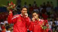 Hendra Setiawan/Markis Kido meraih medali emas cabang bulu tangkis nomor ganda putra di Olimpiade Beijing 2008. (http://wiki.ttymq.com)
