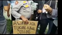 polisi sita poster tukang kawal jogging