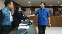 Advokat Lucas usai sidang di Pengadilan Tipikor Jakarta. (Merdeka.com/Yunita Amalia)