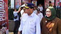 Bupati Bogor Ade Yasin bersama Menhub Budi Karya dalam sebuah acara di Bogor. (Liputan6.com/Achmad Sudarno)