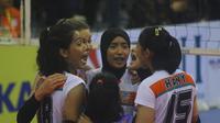 Ekspresi para pemain Jakarta BNI 46 setelah mengalahkan Bandung Bank BJB Pakuan pada final four Proliga 2019 di GOR Joyoboyo, Sabtu (9/2/2019). (Bola.com/Gatot Susetyo)