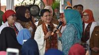 Ibu Negara Iriana Jokowi di Palembang. (foto: Biro Pers Setpres)