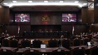 Suasana sidang pendahuluan sengketa hasil Pemilu Legislatif 2019 di gedung MK, Jakarta, Rabu (10/7/2019). Sidang tersebut beragendakan pemeriksaan pendahuluan terkait Perselisihan Hasil Pemilihan Umum DPR-DPRD Provinsi Sulawesi Barat. (Liputan6/Johan Tallo)