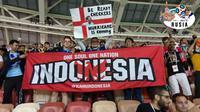 Suporter Indonesia di Piala Dunia memperkenalkan misi One Soul One Nation. (Bola.com/Dokumen Pribadi)