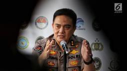 Kepala Divisi Humas Polri Irjen M Iqbal memberikan penjelasan saat jumpa pers terkait perkembangan kerusuhan 21-22 Mei 2019 di Jakarta, Selasa (11/6). Polisi Telah menetapkan 6 tersangka perencana pembunuhan terhadap 4 tokoh nasional.  (Liputan6.com/Johan Tallo)