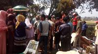 Pemakaman salah satu pemilih pilkada Garut (Liputan6.com/JAyadi Supriadin)