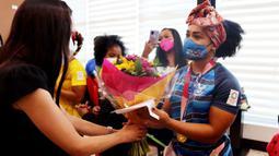 Neisi Patricia Dajomes Barrera sukses meraih medali emas usai berhasil menjadi yang terbaik pada pertandingan angkat besi 76kg putri di Olimpiade Tokyo 2020. (Foto: AFP/Ecuador's Ministry of Sports)