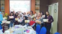 Komunitas Ruang Mama program #MamaBisa diresmikan di Surabaya, Selasa (10/3/2020). (Liputan6.com/ Dian Kurniawan)