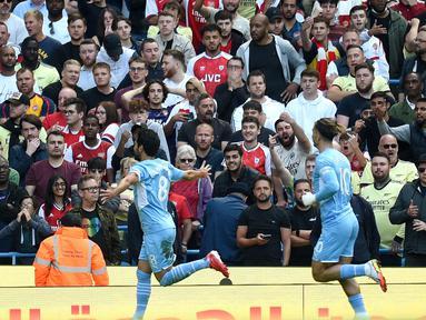 Bermain di kandang sendiri, Manchester City tampil menekan sejak bola digulirkan. Pertandingan baru berjalan tujuh menit, The Citizens mampu unggul lebih dulu berkat gol yang disarangkan Ilkay Gundogan. (Foto: AFP/Oli Scarff)