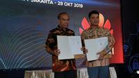 Kepala BSSN Letjen TNI (Purn) Hinsa Siburian dan CEO Huawei Indonesia Jacky Chen. Liputan6.com/Agustinus Mario Damar
