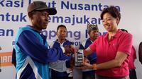 Sosialisasi aplikasi Laut Nusantara oleh XL Axiata di Kampung Mandar, Banyuwangi, Jawa Timur, Kamis (4/4/2019). (Liputan6.com/ Agustin Setyo W).