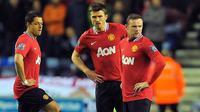 Reaksi Wayne Rooney dkk usai Manchester United tertinggal dari Wigan Athletic 0-1 pada partai lanjutan Liga Premier di DW Stadium, 11 April 2012. AFP PHOTO/ANDREW YATES