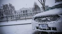 Badai Salju menghantam kawasan Pantai Timur AS pada 12-14 Januari 2019 (AFP/Eric Baradat)