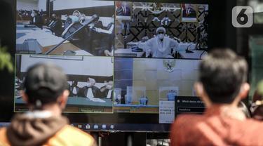 FOTO: Sidang Perdana Rizieq Shihab, Massa Pendukung Geruduk PN Jakarta Timur
