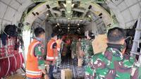 Hercules Milik TNI AU mengangkut logistik ke Pulau Galang. (Foto: dokumentasi TNI)