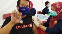 Jurnalis Liputan6.com di Surabaya divaksin Covid-19. (Ist)